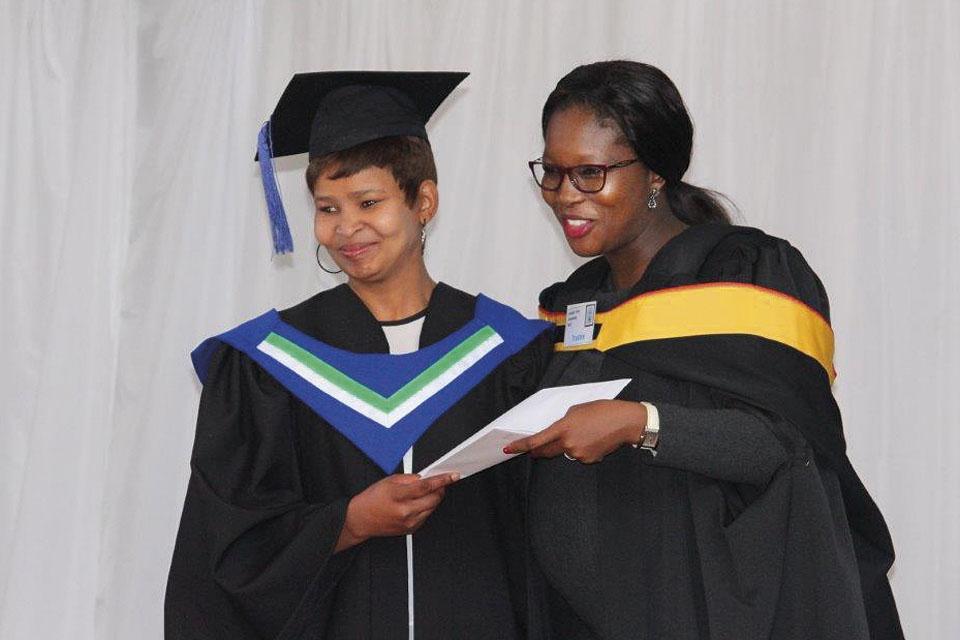 HCEt graduate receives a diploma