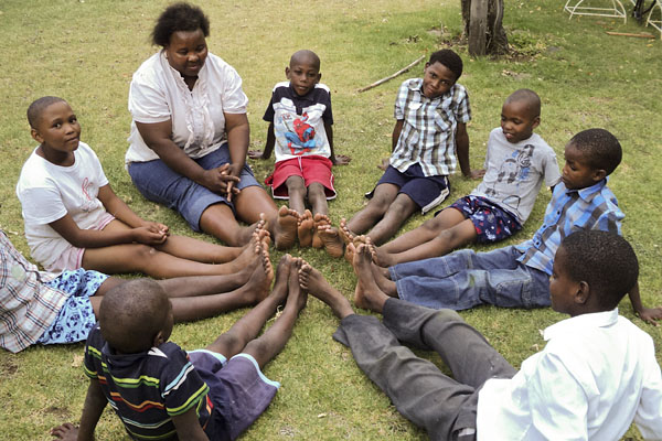 The lay consellor Lettie Martins with learners at Poplar Grove Farm.